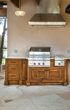 This custom outdoor kitchen cabinetry was crafted using salvaged lumber. The cabinets fit a BBQ grill with burner and a yet to be installed wine cooler. Large Bbq, Solid Wood Kitchens, Rustic Kitchen Cabinets, Bbq Grill, Kitchen Design, Contemporary, The Originals, Outdoor, Ideas