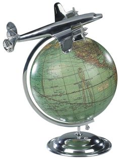 vintage airplane decor   An authentic replica of a vintage travel agent globe recalls an era ...