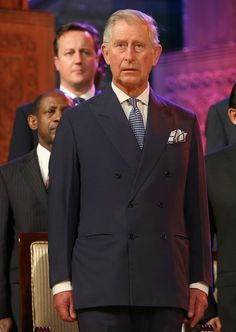 Prince Charles, Prince of Wales stands in front of British Prime Minister David Cameron on stage during the Commonwealth Heads of Government 2013 Opening Ceremony at the Lotus Theatre on November 15, 2013 in Colombo, Sri Lanka.