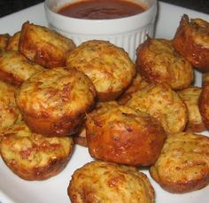 Pizza Puffs: 3/4 cup flour 3/4 teaspoon baking powder 1 tablespoon Italian seasoning pinch of salt 3/4 cup whole milk 1 egg, lightly beaten 1 cup shredded mozzarella cheese 1/4 cup grated parmesan cheese 1 cup cubed pepperoni 1/2 store bought pizza sauce