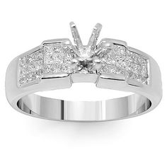 This brilliant diamond ring is crafted in 14K White Gold. The side stones consist of small princess cut diamonds total to additional 0.82 carats. The frame measures to 3/16 inches in width and weighs approximately 5 grams. This glamorous engagement ring setting is an ideal gift for that special someone. $712