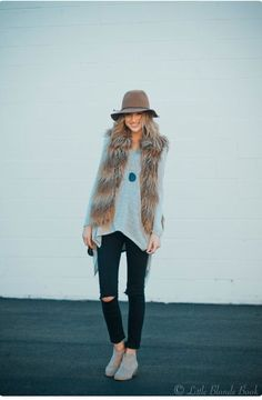 Faux fur, fadora hat, ripped jeans and swede boots