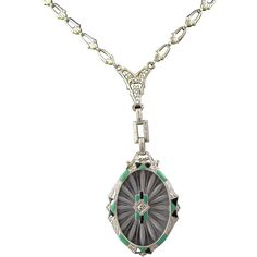 Offering a camphor glass enamel necklace with a diamond at center.  Very Art Deco in style and color, its green and black enamel is in excellent