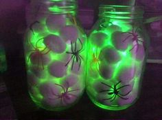 Mason jar, glow stick, spiders, cotton balls