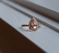 Peach champagne tear drop sapphire and rose gold diamond ring. Wow.