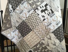 This adorable woodland animals themed quilt features bucks, deer, moose, arrows and modern chevrons in neutral colors ranging from white, cream, and tan to gray and brown. The prints are modern yet rustic. The baby size is good for decoration or a play mat while the toddler size is a little bigger and will grow with your child. The toddler size also fits a crib mattress like a bedspread.  Choose from two sizes using dropdown box above.  -Baby 38 x 45 -Toddler 40 x 56  Available as pictured…