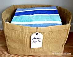 Linen closet organization by Simplicity In The South. Beach towel jute bin.  I'm a bit of a bin/basket fanatic! This one usually goes with us on trips to the beach, so it will be grab-and-go.
