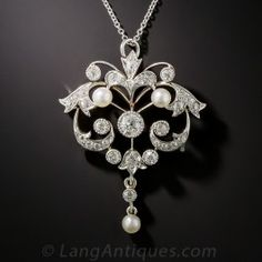 <p>This charming Edwardian jewel, dating from the first or second decade of the last century, is expertly and his artfully handcrafted in platinum over 15K gold (hence more than likely of British origin). Measuring 1 1/2 by 1 1/8 inches, the curvaceous open design glitters with over 1 carat of bright white European-cut diamonds, plus a trio of small, lustrous natural pearls. A refined and ravishing <em>Belle Epoque</em> beauty.</p>