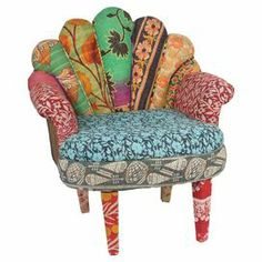 "Mango wood-framed accent chair with a peacock-inspired design and exotic textile upholstery.  Product: Accent chairConstruction Material: Mango wood and vintage Kantha throwsColor: MultiDimensions: 29"" H x 20"" W x 30"" DNote: Due to construction of the product, wear is expected. Actual colors and style may vary."