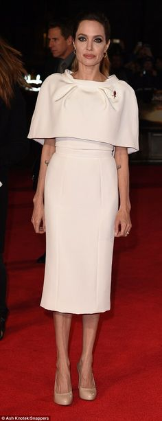 Ink-mad: Angelina's numerous tattoos were visible on her body despite the modest cut of her dress