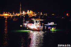 Boating off into the night after a Nantucket Wedding at the Great Harbor Yacht Club by Zofia & Co. Photography #nantucket #weddings #nautical #sailoff