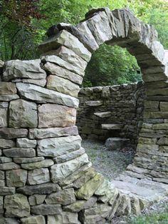 Stone wall 5-6', Round portal, steps built as part of  wall. Chuck Eblacker