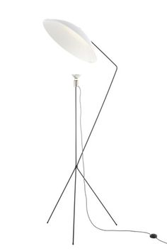 Solveig by Avril de Pastre |    Solveig means 'path of the sun' in Swedish. Floor lamp with reflector sheet steel in gloss white lacquer. The shade is connected to the base by a magnet, which enables the angle of the reflector to be modified. ~Ligne Roset