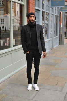 Black beanie, black polo neck, black jacket, black jeans, white plimsols