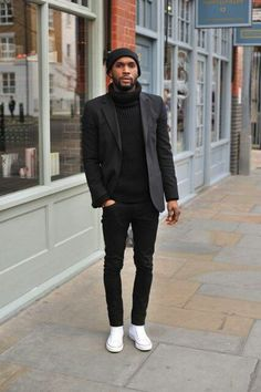 Black beanie, black polo neck, black jacket, black jeans, white plimsols