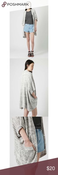 Topshop Salt & Pepper Cape Cardigan Slouchy salt and pepper yarn cardigan in a relaxed silhouette with handy side pockets. 78% Cotton, 21% Acrylic, 1% Nylon. Machine wash. Only worn twice, EUC. Topshop Sweaters Cardigans