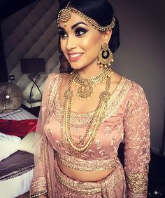 Radiant #realbride #inspiration in a gorgeous blush toned #wedding #lehnga. #Love the beautiful #gold #bridal #jewelry as well. #repost @reshmamakeupartist #pink