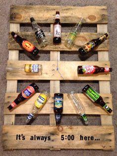 Pallet, beer bottles, clock hands, caulk, and sticker letters