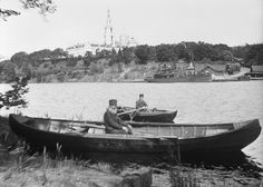 Lake Ladoga, Valamo Monastery, Karelia, Russia. Monks in rowboats at Lake Ladoga. In the background is the Valaam Island with the Russian Orthodox monastery.