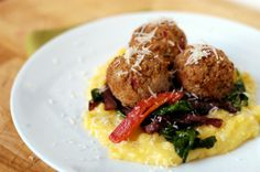 Cauliflower and red pepper balls over polenta, spinach and caramelized onions