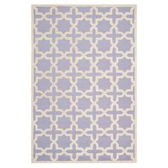 Wool rug in lavender with a trellis motif. Hand-tufted in India.