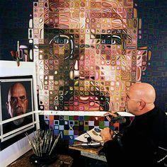 Chuck Close at his studio desk.