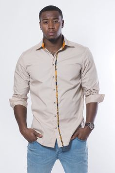 Dress it up or dress it down... this new African-inspired men's shirt has just a hint of African print. A very versatile piece for your wardrobe.
