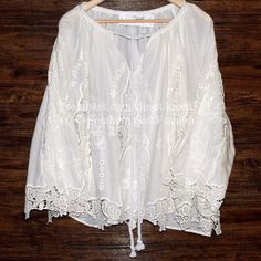 BOHEMIAN TUNIC Vintage Embroidered Oversize Eyelet Size XS/Small. New with tags.  $68 Retail + Tax.  Oversized tunic with brocade detailing.  Optional tie front closure. 3/4 length wide sleeves. Unlined, sheer.  Size XS/S will fit up to a size medium.   100% cotton.  Imported.     ❗️ Please - no trades, PP, holds, or Modeling.    Bundle 2+ items for a 20% discount!    Stop by my closet for even more items from this brand!  ✔️ Items are priced to sell, however reasonable offers will be…