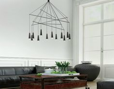 This minimalist chandelier is made from conical metallic elements that hide LED lights within. - MIKADO Pendant Chandelier by Filippo Mambretti for Morosini Pendant Chandelier, Pendant Lighting, Chandelier Ideas, Industrial Lighting, Luminaire Original, Lustre Design, Contemporary Chandelier, Chandeliers Modern, Iron Chandeliers