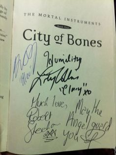 The Mortal Instruments: City of Bones book signed by the cast. Amazing.  I am reading this book now and it is amazing!  One of the best books I have ever read!  Highly recommend if you liked the Hunger Games and Divergent