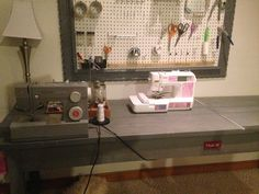 Diy sewing table with metal ridge for straight cutting and embedded ruler for measuring fabric up-cycled wood with cork board organizing tools frame also upcycled from thrift store ❤️ handmade sewing table - mason jars for organizing