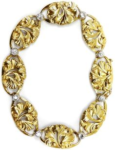 Art Nouveau gold and diamond bracelet, French c.1890,  the eight penwork gold panels of ovoid outline, each with a foliate motif, diamond collet set joins. Via S.J. Philips.