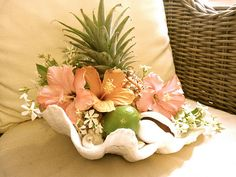 Such creativity.  A pineapple, lime, shell and flowers.