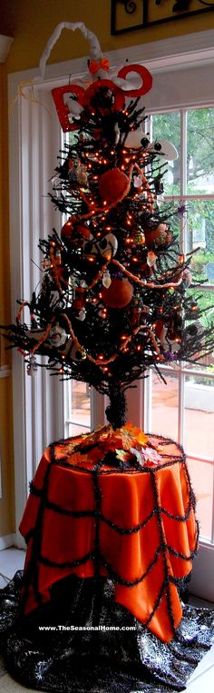 love the tablecloth halloween tree - Halloween Tree Decorations