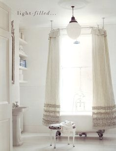 A fabulous fixture and sweet DIY shower curtains are the focal point for this bright, airy bathroom. Double Shower Curtain, Double Curtains, Bad Inspiration, Bathroom Inspiration, Interior Exterior, Interior Design, Ruffle Shower Curtains, Diy Shower, Shower Rod