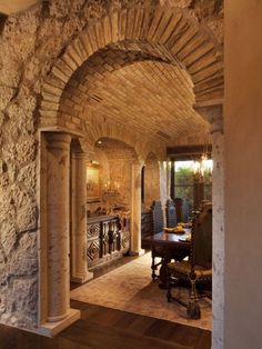 Stone & Brick Archway Leading Into Tuscan Dining Room Image courtesy of Gene Northup of Synergy Sotheby's International Realty? Tuscan Dining-rooms from Thom Oppelt on HGTV