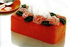 Crochet tissue box cover . No pattern but basic box with appliquies.Shows other ideas for toppings