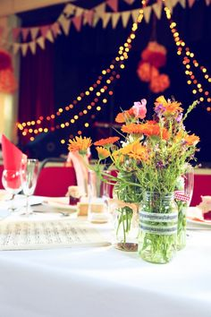 jam jar flowers DIY Colourful Village Hall Wedding http://myfabulouslife.co.uk/
