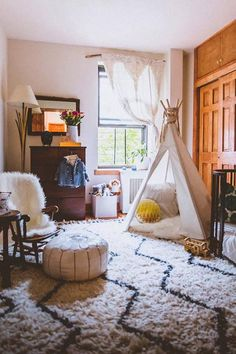 Top 10 Nursery Design Trends of 2015 | A teepee, fur throw, and arrow prints give way to a wild, Western inspired room.