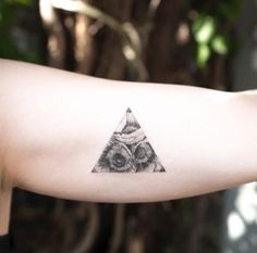 Poppy-filled triangular tattoo design by Hongdam