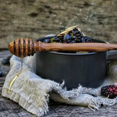 Handcrafted honey dipper with rustic oatmeal, berries and raw honey. Moody food photography, linen & raw wood photo backdrop.