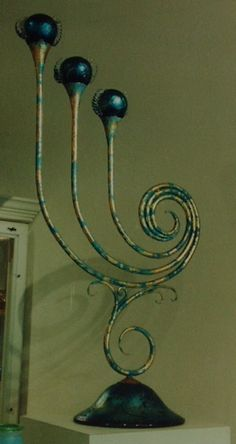 Bruce Pringle forged iron candleabra with Colin Heagney glass base and candle cups. Painted and gold leafed.