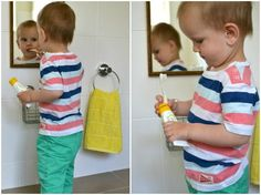 A low mirror is placed to the child can care for himself. Notice the low hand towel and basket on wall for him to be independent.