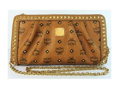 MCM Studded Crossbody Clutch $1000.00, originally $1330.00. This Clutch is sold through Shop-Hers.com - Closet name - Pommeverte