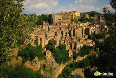 Europe's Most Beautifully Precarious Villages Sorano, Italy - In a region as enchanting as Tuscany, picking the most beautiful village can be a tricky affair; selecting the most striking village, however, is easy: Sorano.