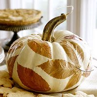 Great centerpiece for Fall Table or elsewhere inside or outside your home: White pumpkin shown here decorated with colorful fall leaves using a thin layer of Mod Podge to attach to pumpkin & then another layer on top of the leaves