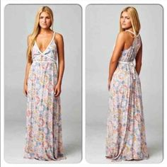 """⭐️LAST ONE!⭐️NWT Boho Tapestry Maxi Dress NWT Boho Tapestry Maxi Dress. Beautiful coral, gray, cream and yellow patterns in this adorable maxi dress! Flowy style with braided accent trim and belted tie in the back. Fabric is 100% Rayon. Length is approx 55"""". Available in M (6-8)🚫No Trades and No Paypal🚫sold out of smalls, larges Dresses Maxi"""