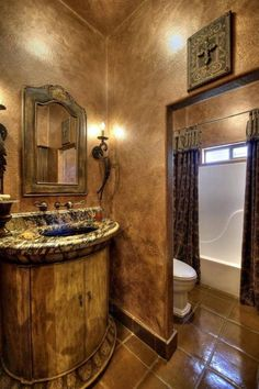 Tuscan Bathroom With Wall Sconces And Wooden Vanity | Tuscan ... on