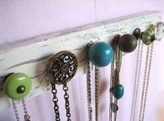 Old piece of wood, spray paint, screws, and random drawer pulls. Perfect for hanging jewelry!