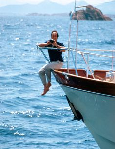 Prince Aga Khan on the prow of his yacht photographed by Slim Aarons.
